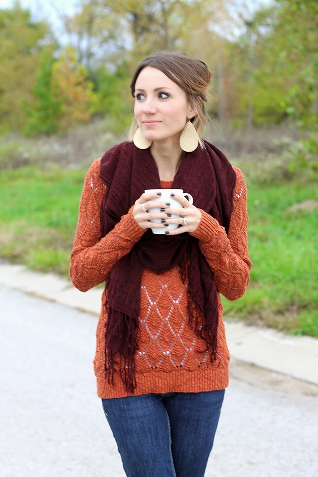 Maroon scarf, orange sweater