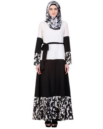 Model Gamis Batik Kombinasi Satin Dan Kain Polos Yang Modern