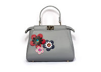 Flower Power:  Gray Karyn bag with floral patches