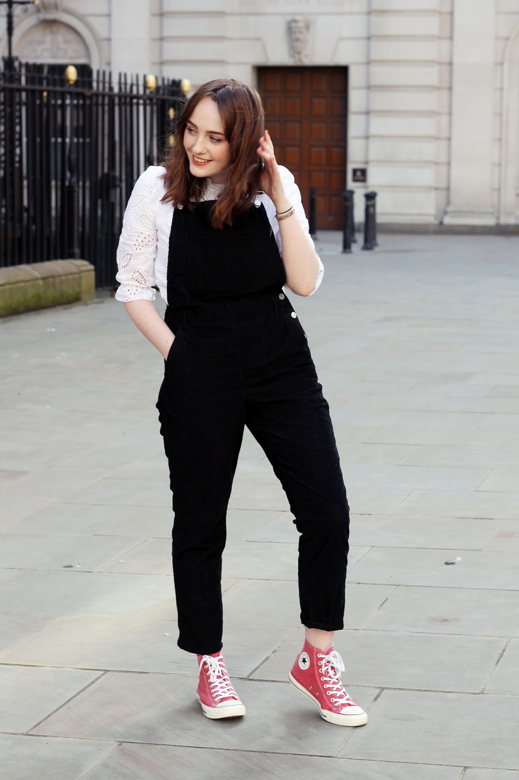 UK style blogger styling dungarees with white blouse and converse