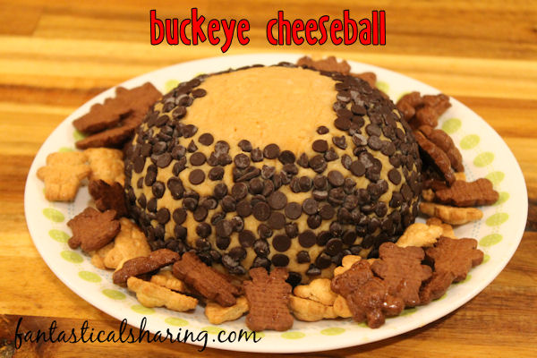 Buckeye Cheeseball // This treat is especially perfect for Ohio State fans on game day! But you don't have to be a born and bred Buckeye to enjoy this sweet pb and chocolate appetizer! #recipe #appetizer #gameday #buckeye #cheeseball #ohio