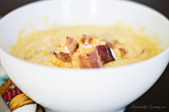 This Creamy Potato Soup is the perfect comfort food for fall weather featured at Talk of the Town at www.knickoftime.net