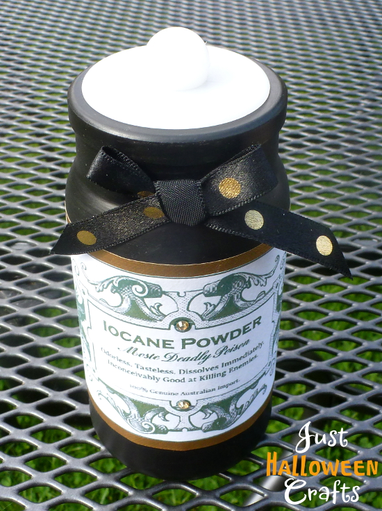 black painted jar with iocane label and satin bow detail