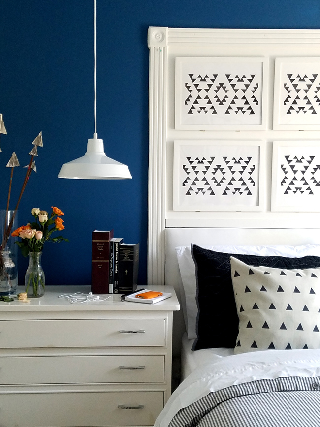 arrows and black and white prints with a navy blue background wall