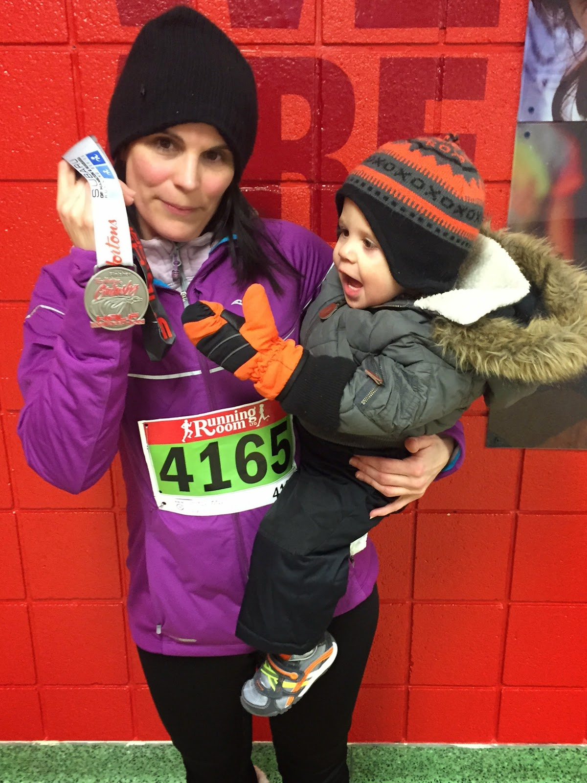 image of Lucie on Race day showing off her finisher medal