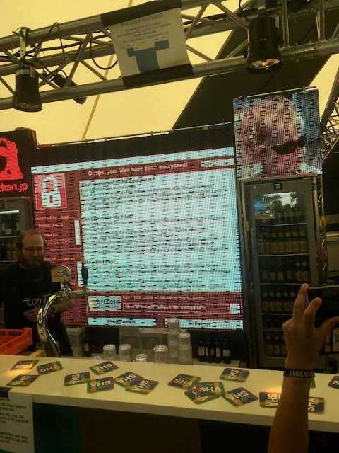 LED displays showing images and a cryptolocker ransom screen behind a bar
