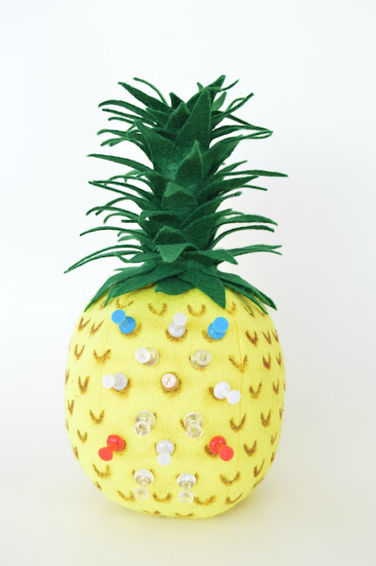 3D felt pineapple used as a  pin cushion