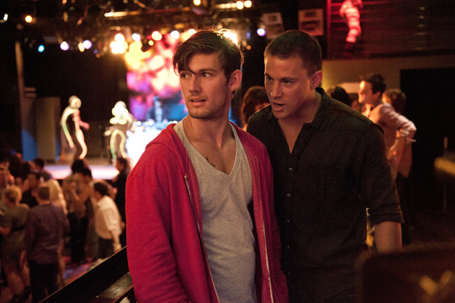 A couple of male dancers in street clothes in Magic Mike movieloversreviews.filminspector.com