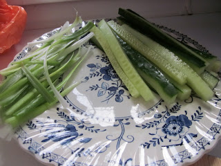 Sliced spring onion and cucumber