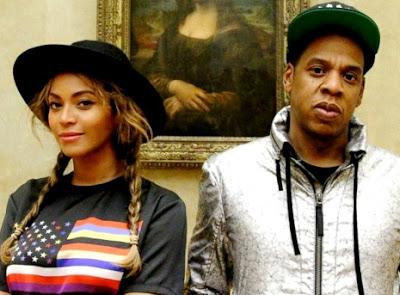 Foto de Jay-Z posando con su pareja