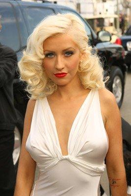 Christina Aguilera braless Photos