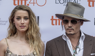 Amber Heard and Johnny Depp Settled their divorce. Find out how mush Amber gets at JasonSantoro.com