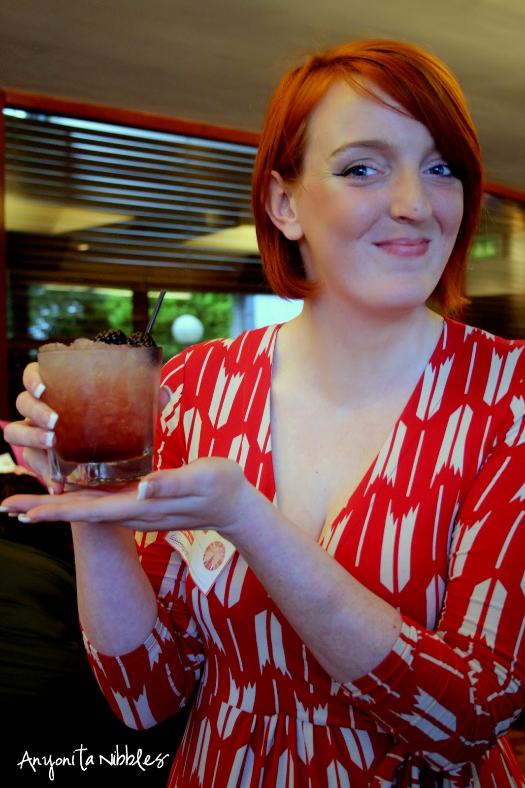 Charlotte from Gin and Ginger models a Bramble cocktail from Anyonita Nibbles