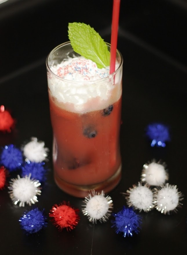 Watermelon blueberry mojito in a clear glass