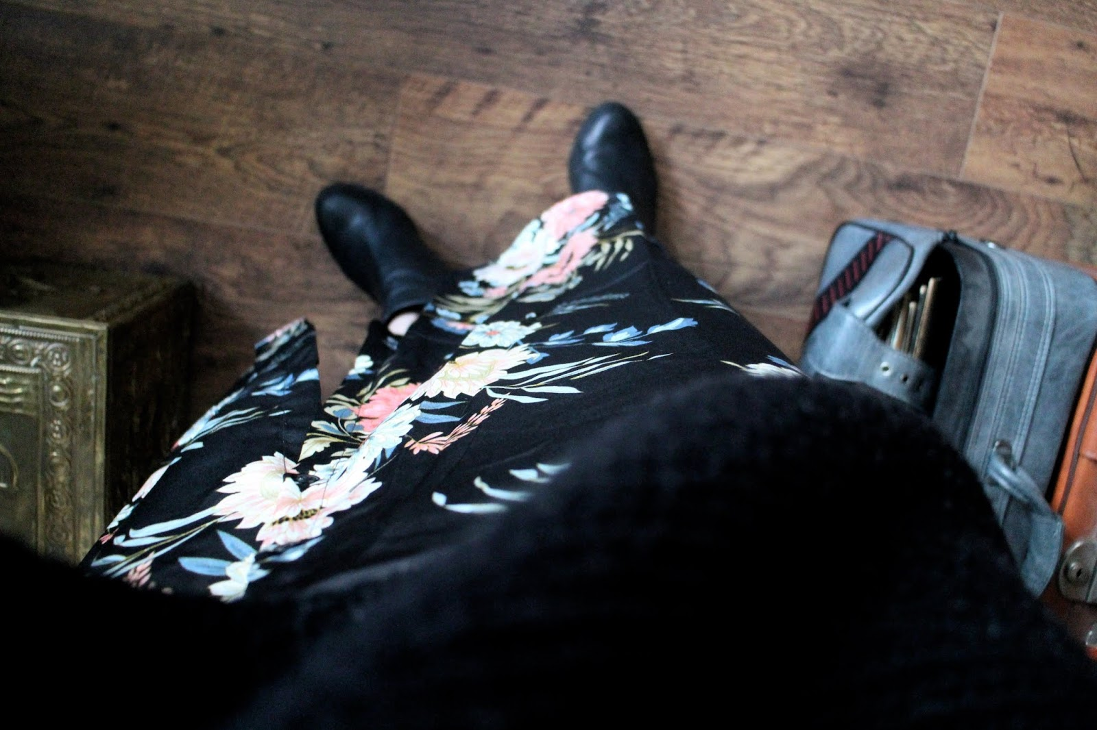 Shot from above, black jumper, maxi dress and shoes on wooden floor