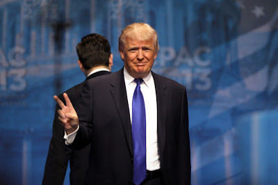 Donald Trump gives a peace sign at CPAC 2013 conference.