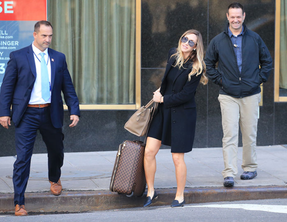 Donald Trump's pregnant daughter-in-law melts hearts as struggles with her luggage while her security guards watch