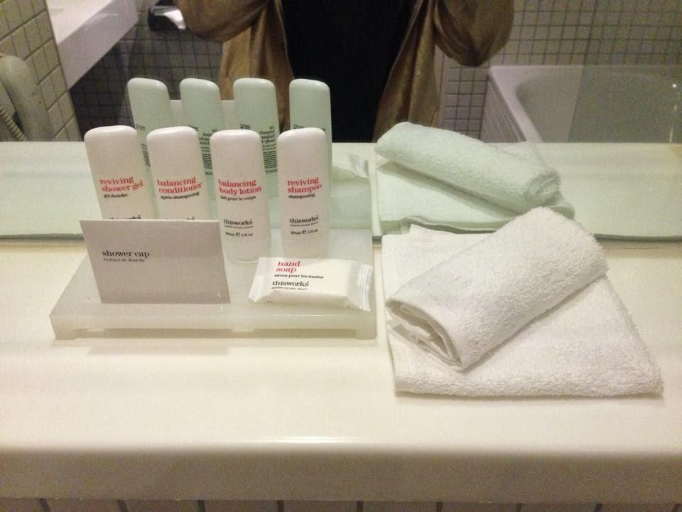 bathroom shelf with toiletries and face cloths