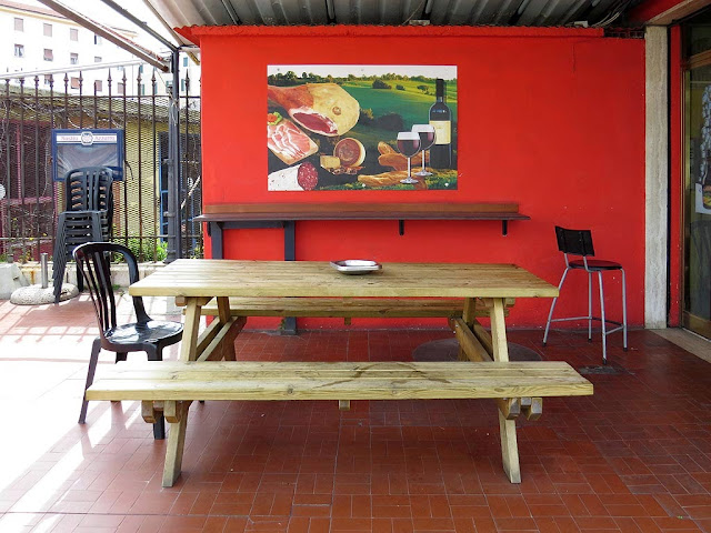 Wooden table and seatings, Bar Mediceo, piazza dell'Arsenale, Livorno