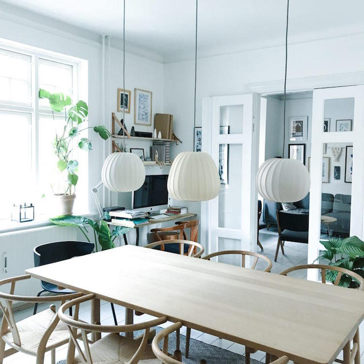 Dining table with George Nelson bubble lamps and Hans Wegner Chairs