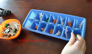 Halloween fine motor center using tweezers to move erasers