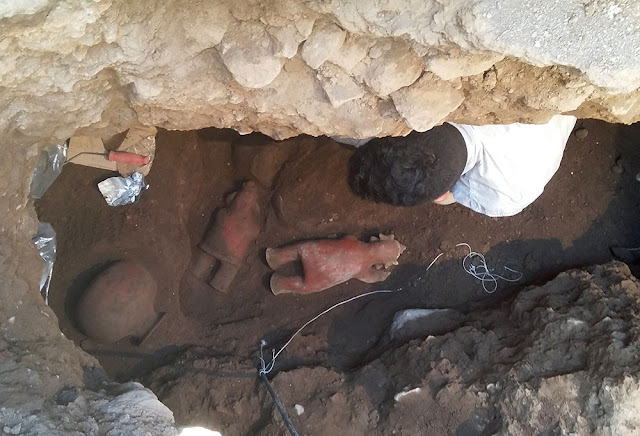 1,700 year old tomb in Mexico yields a dozen skeletons, two figurines and a pot