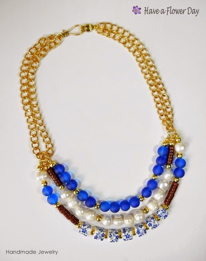 ANAFI. Gargantilla con cerámica, perlas y cristal · Choker necklace with ceramic beads, pearls and crystal.