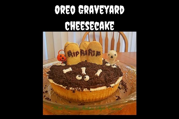 this is a scary looking Halloween grave yard cheesecake with crushed oreo cookies on top, bones, eyes and pumpkins on top along with grave yard milano cookies with tombstone messages on them a ghoulish treat for Halloween party fun thats delicious the cheesecake is a homemade recipe from scratch from my hometown Utica New York