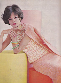 A lady in a 1960s knitted skirt suit