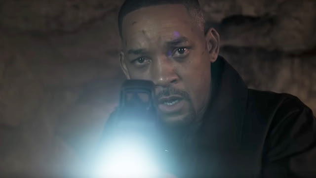 will smith with a rifle and a shocked expression