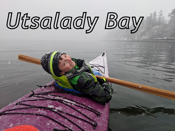 Myles paddling in a snowstorm in Utsalady Bay with a Kid's Greenland kayak paddle from NorthPoint Paddles