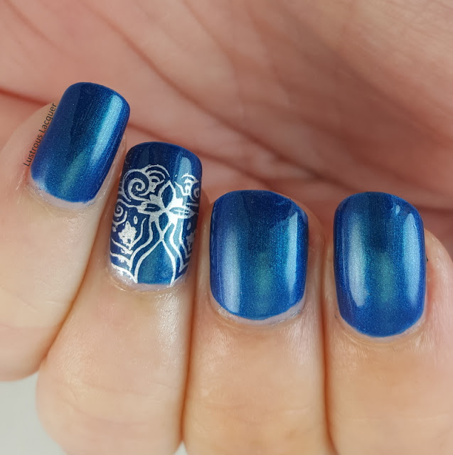 Blue-teal-multi-chrome-nail-polish-stamped-accent