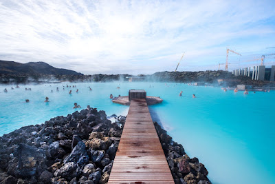 Volcanic rocks, walkway and bathers at Iceland's Blue Lagoon