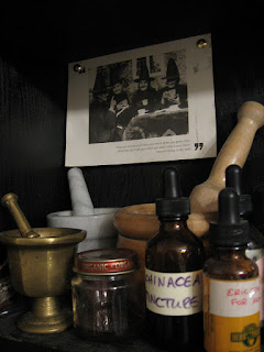 mortar, pestle, tincture bottles
