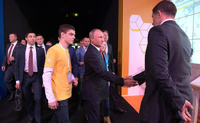 Vladimir Putin visiting the ProyeKTOriya national professional orientation forum.