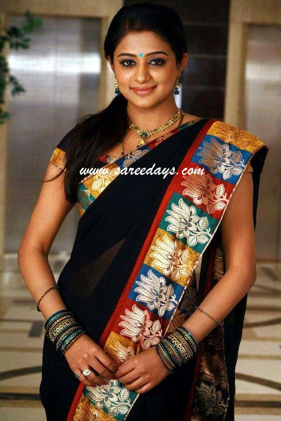 Latest saree designs priyamani in blue georgette saree checkout priyamani in blue georgette saree with lotus appliqued border and paired with matching short sleeves blouse altavistaventures Image collections