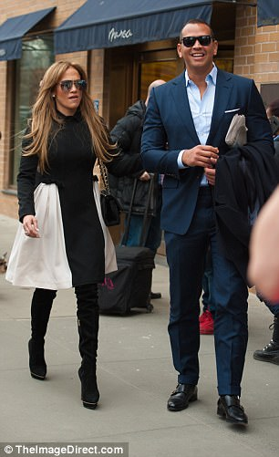Singer Jennifer Lopez & her man step out in style