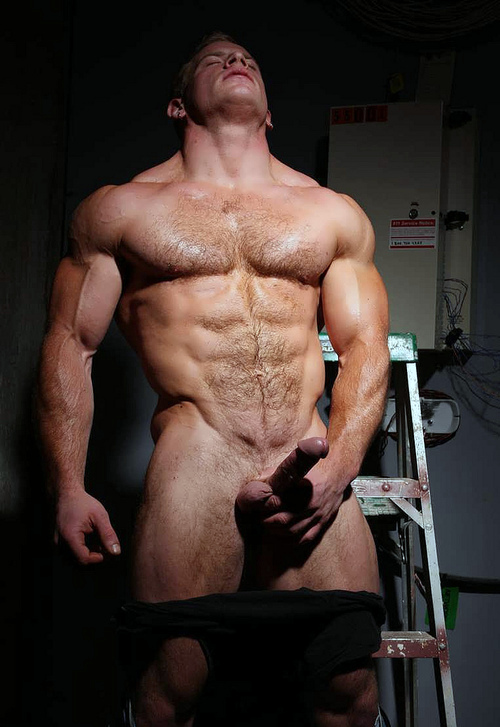 His massive cock stands upright as he flexes his tight hard muscle