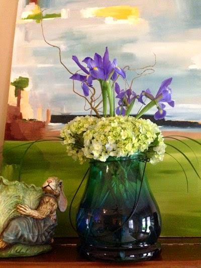 Porcelain Easter rabbit and bouquet of flowers sets atop piano