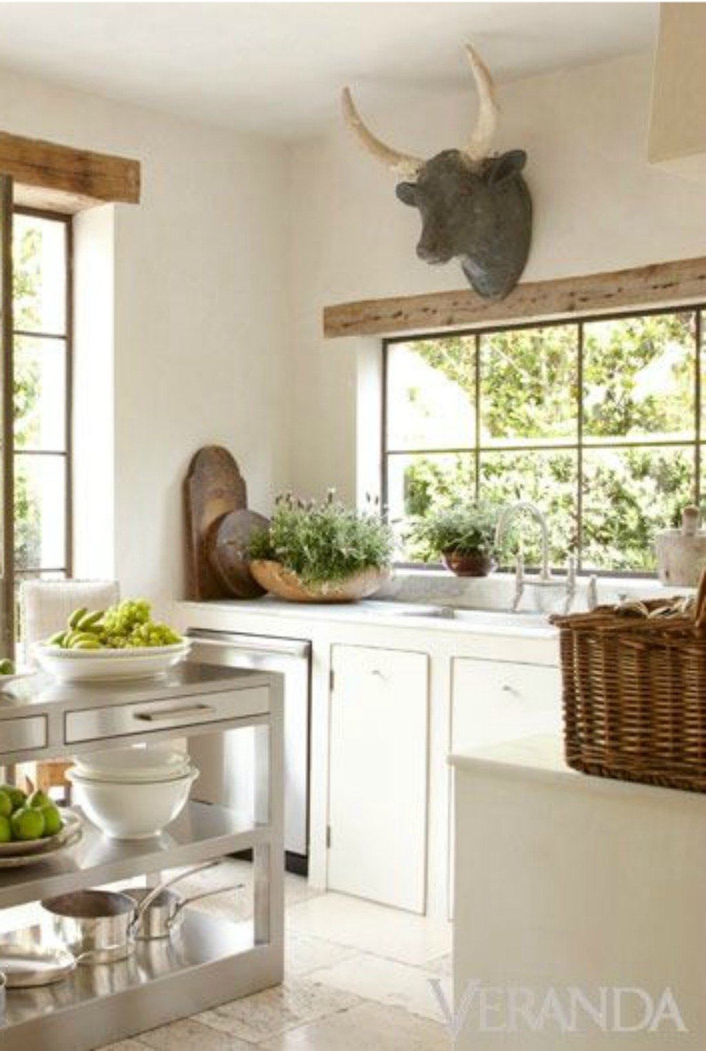 Pamela Pierce #Frenchfarmhouse kitchen with ox head, white cabinets, and stainless work island on Hello Lovely Studio
