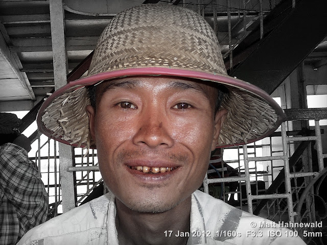 Burma, Myanmar, Yangon, Burmese man, people, street portrait, headshot, focal black and white, straw hat