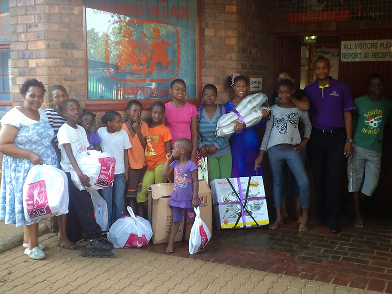 Hollywoodbets Daxina team with donations of kitchen and sports equipment for the SOS Childern's Home in Ennerdale