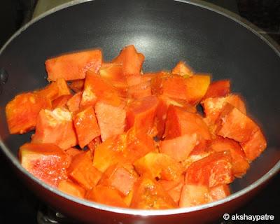 papaya pieces in a pan