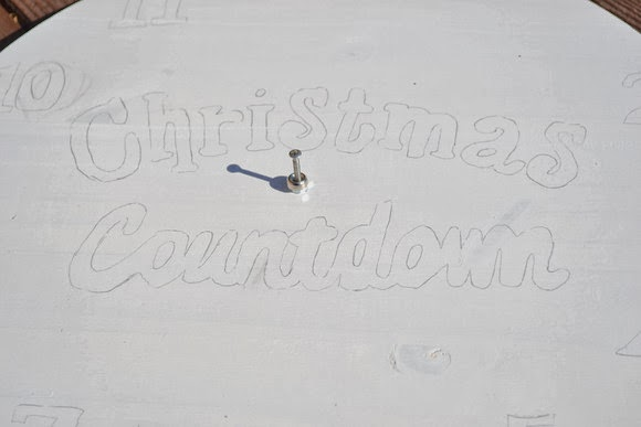 Outline the letters and numbers for your Christmas countdown clock lightly in pencil
