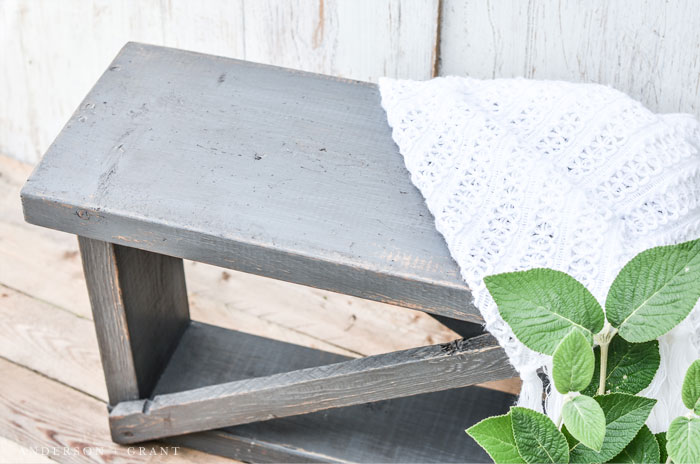 Learn how to add extra vintage charm to this distressed farmhouse style bench.  #DIY #furniture #furnituremakeover #andersonandgrant
