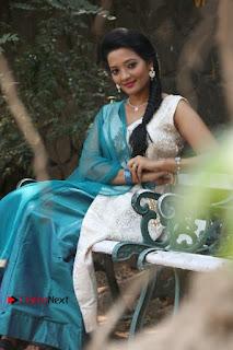 Tamil Actress Koushika Stills in White Salwar Kameez at Inayathalam Tamil Movie Audio Launch  0010.jpg