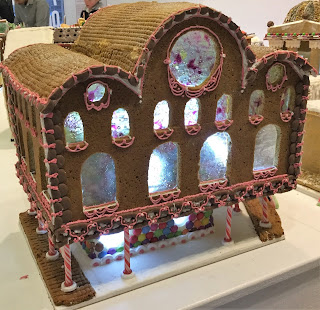 Pic of elaborate Gingerbread station with large windows and pillars