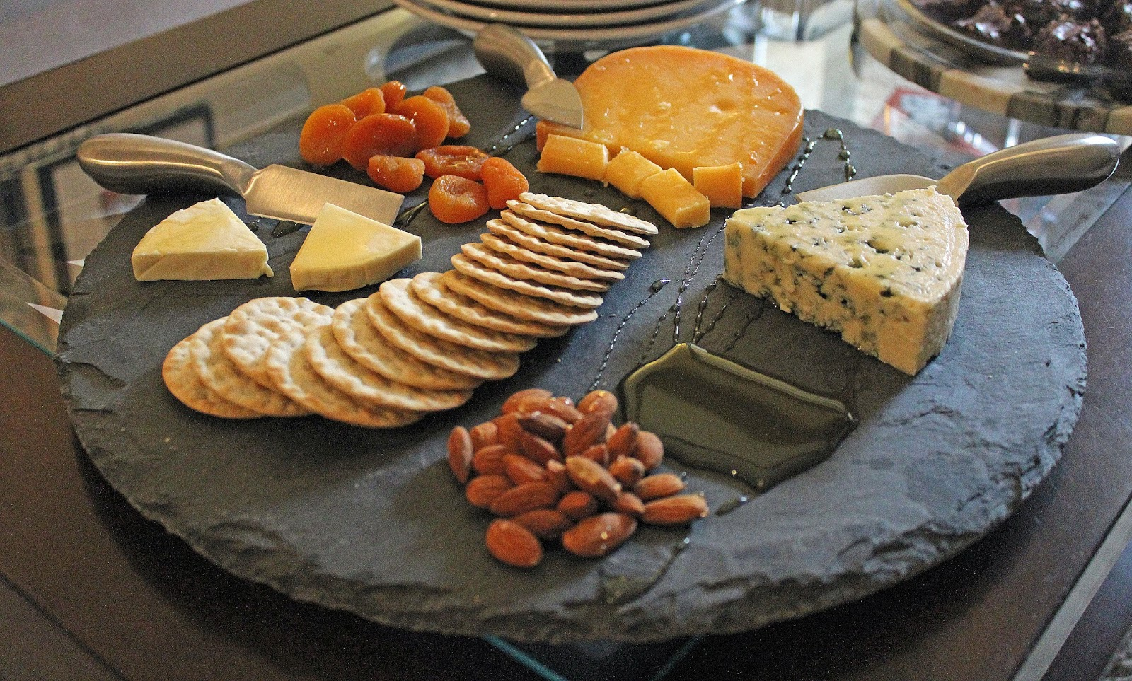 secondly pick your cheeses and crackers. be sure to get at least one type of cheese that everyone will like such as smoked gouda or even a white cheddar. & perfecting your cheese plate