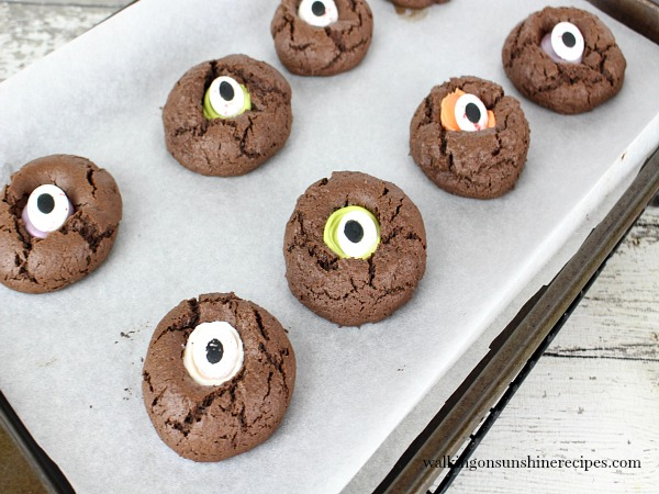 Halloween Thumbprint Cookies on baking tray with eye candies from Walking on Sunshine Recipes