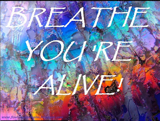 Image of Rainbow Shining through cracked Ice with text 'Breathe You're Alive!'